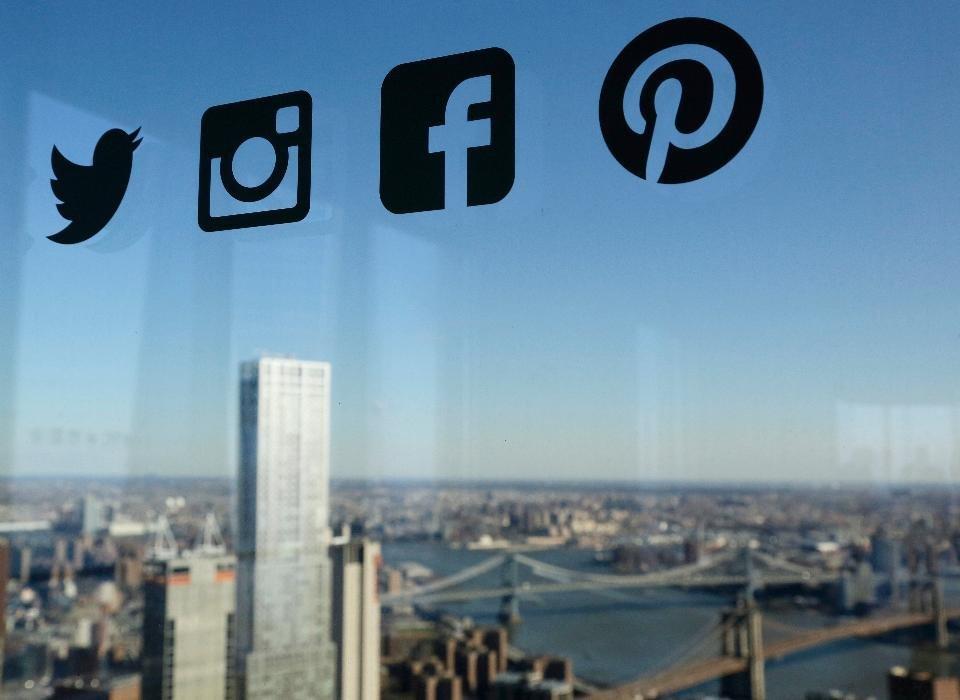 social media logos on window of city